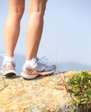 Hiking legs stand seaside rock Royalty Free Stock Photo
