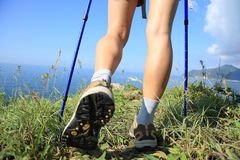 Hiking legs walking on seaside mountain Royalty Free Stock Images