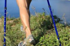 Hiking legs walking on seaside mountain peak Stock Photos