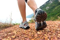 Hiking legs walking on seaside trail Stock Images