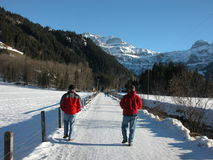 Hiking in Lenk, Switzerland. A view of two intrepid hikers walking the main pathway in Lenk Switzerland Stock Images