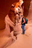 Hiking Lower Antelope Canyon. Hiker basks in the bronze glow of Lower Antelope Canyon near Page, Arizona. Lake Powell Navajo Tribal Park Royalty Free Stock Image