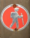 Hiking man. Closeup of an orange hiking symbol on a tree Royalty Free Stock Images