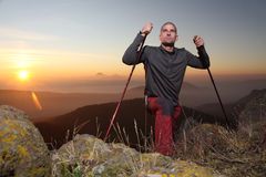 A hiking man. Reaching the mountain top Royalty Free Stock Photo