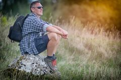 Hiking man with backpack Stock Photos