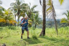 Man with backpack running. Hiking man with backpack running in the wild Royalty Free Stock Photography