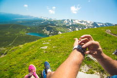 Hiking man checking direction in mountains. Royalty Free Stock Photography