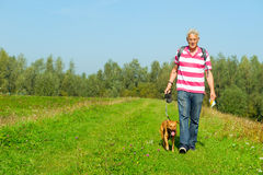 Hiking man with dog Royalty Free Stock Photos