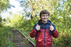 Hiking man. The guy with the backpack hiking in the forest. Hiking Royalty Free Stock Photos