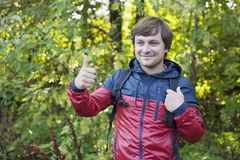 Hiking man 2. The guy with the backpack hiking in the forest. Hiking Stock Image