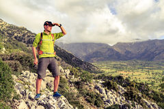 Hiking man looking at beautiful inspirational landscape Stock Images