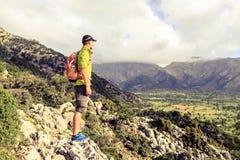 Hiking man looking at beautiful inspirational landscape Royalty Free Stock Photos