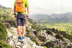 Hiking man looking at beautiful mountains Stock Photos