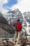 Hiking Man Looking at Moraine Lake & Rocky Mountains Royalty Free Stock Photos