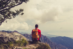 Hiking man or trail runner looking at mountains Stock Photography