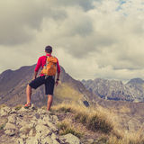 Hiking man or trail runner in mountains Royalty Free Stock Photos