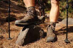 Hiking man with trekking boots on the trail Royalty Free Stock Image
