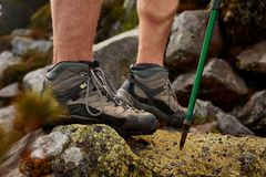 Hiking man with trekking boots on the trail Royalty Free Stock Photo