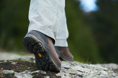 Hiking man with trekking boots Royalty Free Stock Photo