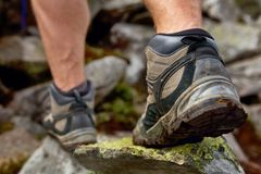 Hiking man with trekking boots on the trail stock photo