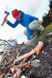 Hiking man try to light fire Royalty Free Stock Photography