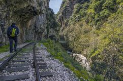 """Hiking at Vouraikos gorge following the Diakopto–Kalavrita """"Odontotos"""" rack railway route. Peloponnese - Greece. Caucasian man with a backpack royalty free stock images"""