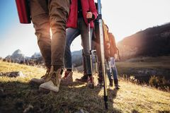Hiking man and woman with trekking boots. On the trail royalty free stock photos