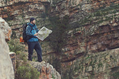Hiking map man. Man with map exploring wilderness on trekking adventure Royalty Free Stock Photos