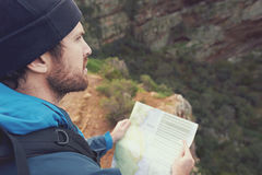 Hiking map man. Man with map exploring wilderness on trekking adventure Stock Photography