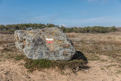 Hiking mark paint `Good direction` on rock Stock Photography