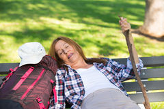 Hiking mature woman resting on bench Stock Photo