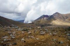 Tongariro alpine crossing,smoke in volcanic crater, new zealand royalty free stock photo