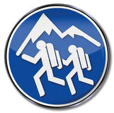 Hiking and mountain hikers. Sign hiking and mountain hikers Stock Photography