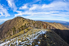 Hiking through mountain landscape in early spring, mount Stolovi Stock Images
