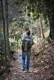 Hiking in the mountains. Young women hiking along a path in the mountains Royalty Free Stock Images