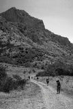 Hiking in the mountains bw. Hiking in the mountains Five people are on the road in the mountains bw Stock Photos