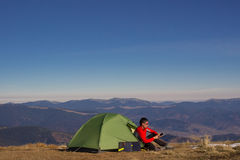Hiking in the mountains. Camping with a tent in the mountains in a beautiful location Royalty Free Stock Photos