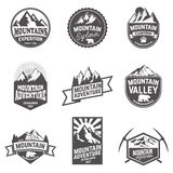 Hiking, mountains exploration labels and emblems. Royalty Free Stock Image