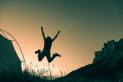 Hiking in mountains. Hiking and jumping in mountains Stock Photo