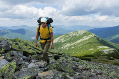 Hiking in the mountains Stock Images