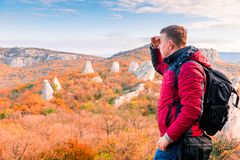 Hiking in the mountains, a traveler admiring the autumn stock photography