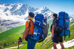 Hiking in mountains. Trekking in spring mountain stock photography