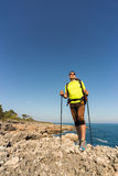 Hiking in the national park along the sea. Stock Photos
