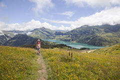 Hiking near lac de roselend in the beaufortain Royalty Free Stock Photo