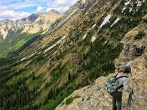 Hiking near the steep edge of a cliff while hiking the Crypt Lak royalty free stock photos