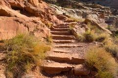Hiking through orange rocks in the desert Royalty Free Stock Images