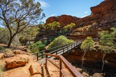 Hiking over the bridge in kings canyon, watarrka national park, northern territory, australia 17 royalty free stock image