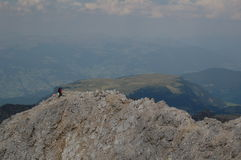 Hiking over the summit of the mountain Stock Photography