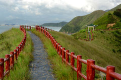 Hiking path. With pavillion on the hill Stock Images