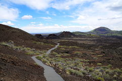 Hiking path along a chain of volcanic cinder and spatter cones